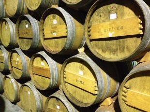 Barrels stacked similarly to the solera aging system.