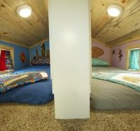 The split loft kids bedroom is above the Brown Bear's bathroom